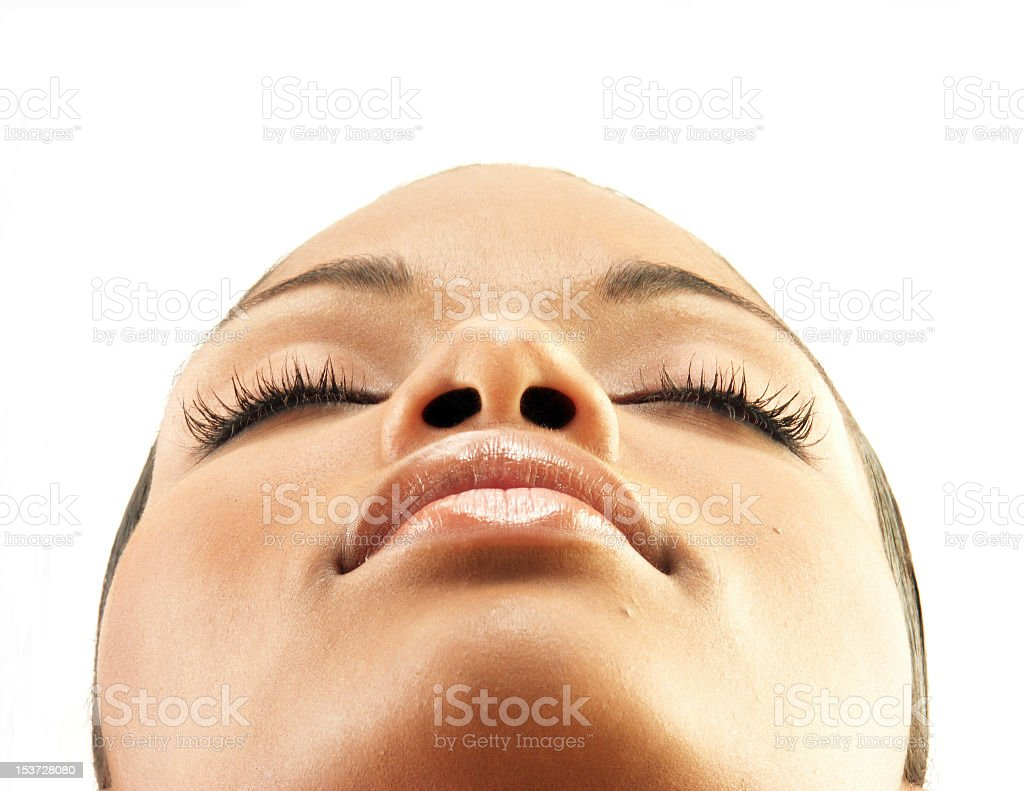 Beauty shot of woman's face tilted back with eyes closed royalty-free stock photo