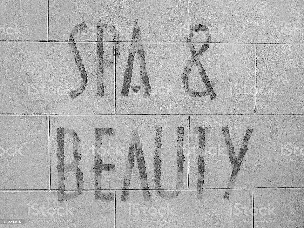 beauty sign pampering brick wall signage stock photo