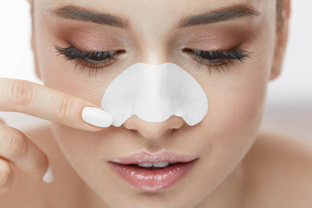Beauty Skin Care. Closeup Of Beautiful Girl With Nose Patch stock photo
