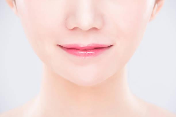 schönheit und hautpflege-konzept - menschlicher mund stock-fotos und bilder