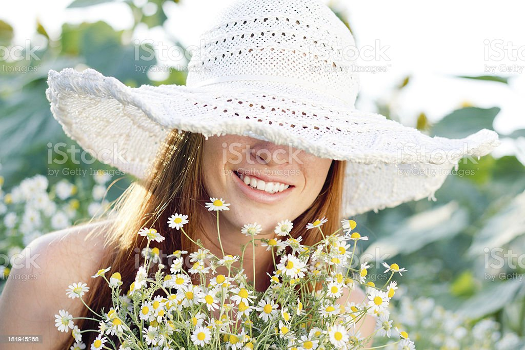 Beauty smile among daisies royalty-free stock photo