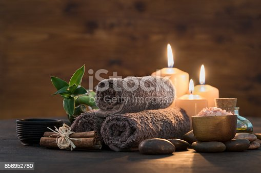 istock Beauty spa treatment with candles 856952780