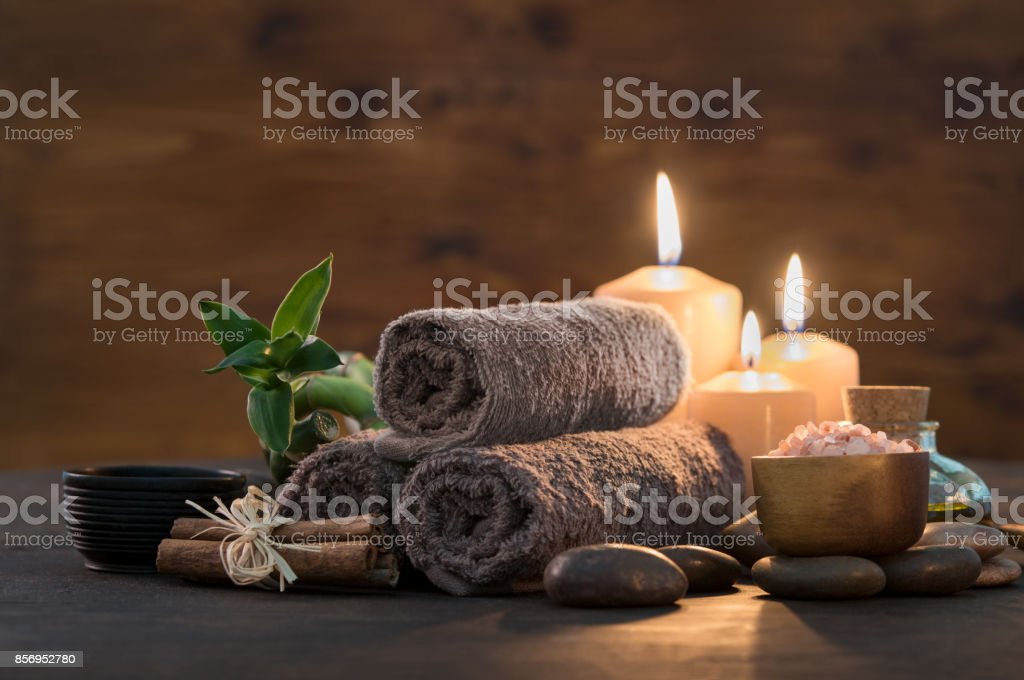 Beauty spa treatment with candles stock photo