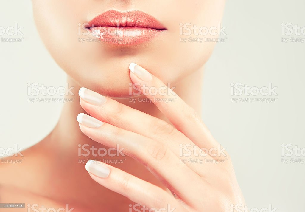 Beauty Spa Woman Portrait. Beautiful Girl Touching her Face stock photo