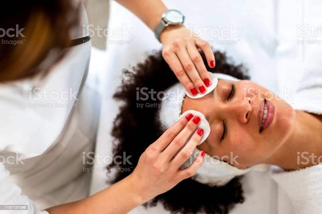 Beauty Specialist Putting Herbal Linings On A Womans Face In A Spa Center Stock Photo Download Image Now Istock