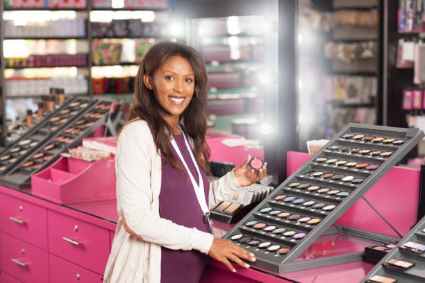 beauty store owner. - makeup for pregnant women stock photos and pictures