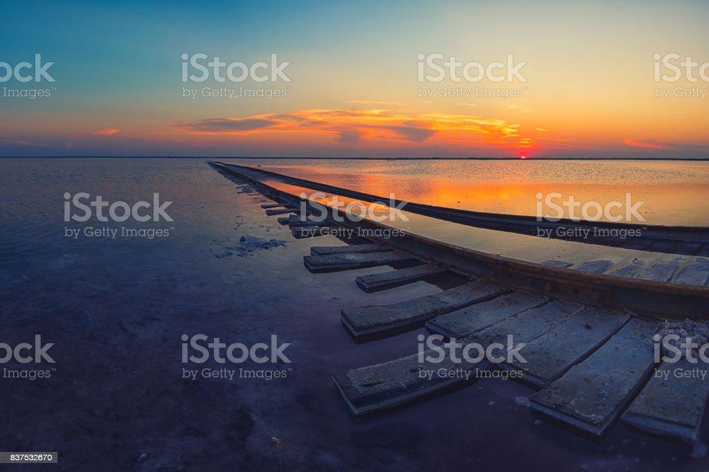 Beauty sunset on salty lake stock photo