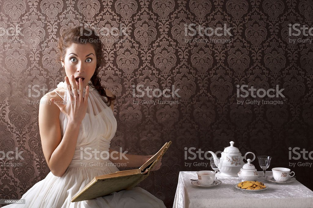 beauty surprise woman read a book in the tea time stock photo