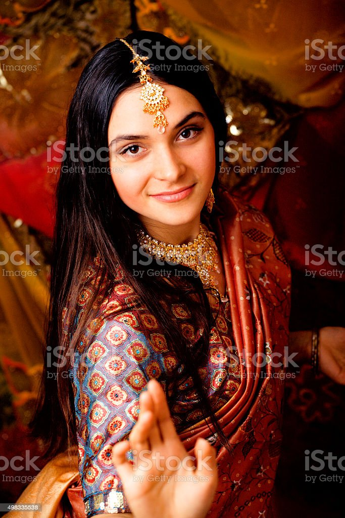 beauty sweet real indian girl in sari smiling on black stock photo