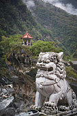 Small traditional Chinese pavilion standing on top of the gorges of Taroko National Park, Taiwan.