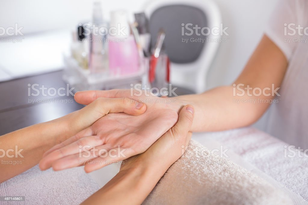 Beauty therapist massaging customers hand royalty-free stock photo