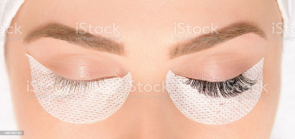 beauty treatment, application of false eyelashes stock photo