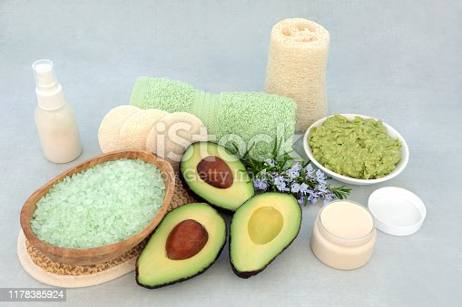Beauty treatment for skincare with avocado face mask, rosemary herb, exfoliation mineral salts, moisturising cream,  lotion & cleansing products.