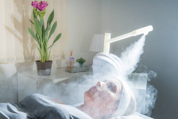 Beauty treatment of face with ozone facial steamer in beauty center. Beaultiful Blonde Girl Beauty treatment of face with ozone facial steamer in beauty center. Beaultiful Blonde Girl. evaporation stock pictures, royalty-free photos & images
