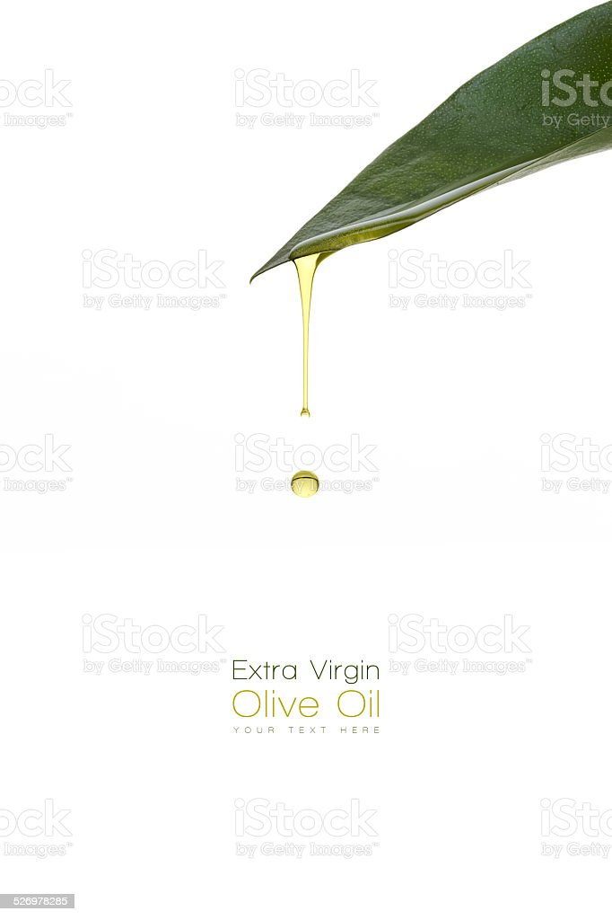 Beauty Treatment. Olive oil dripping from a fresh green leaf stock photo