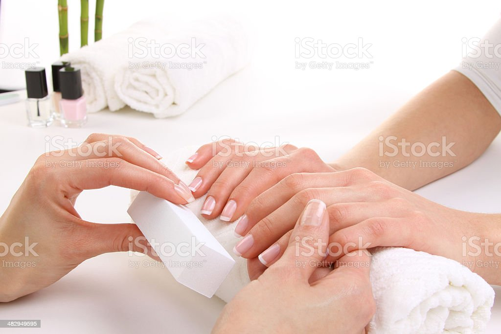 Beauty treatment photo of nice manicured woman palms stock photo
