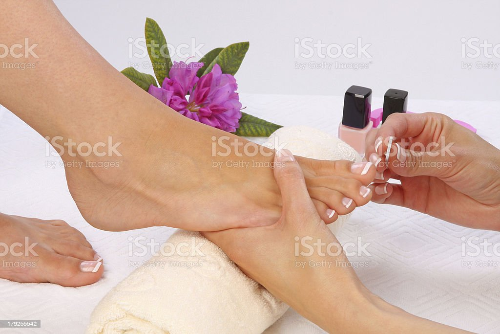 Beauty treatment photo of nice pedicured feet stock photo