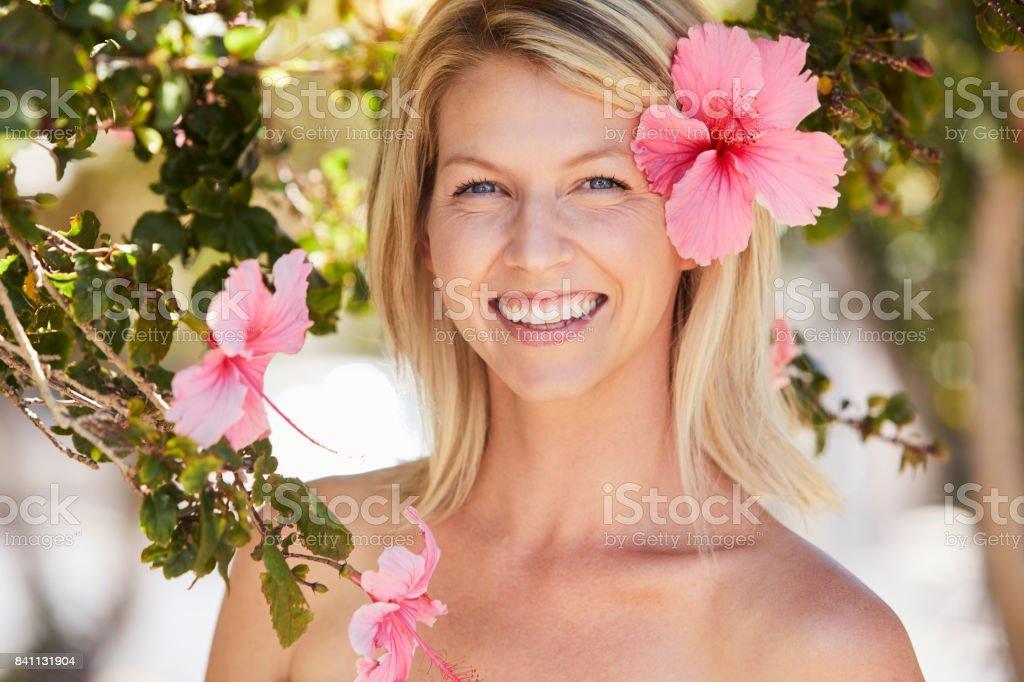 Beauty wearing flower stock photo