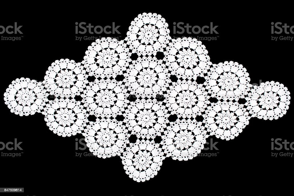 Beauty white rhomboid lace tablecloth isolated on black background, circle partern stock photo
