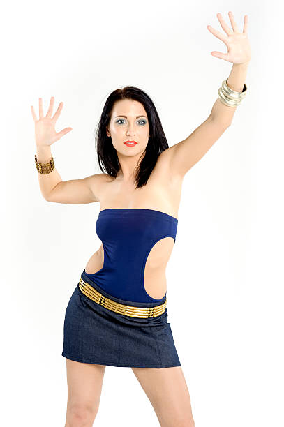 Beauty with a blue top dancing stock photo