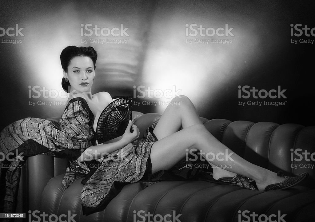 Beauty with a fan.Noir style. royalty-free stock photo