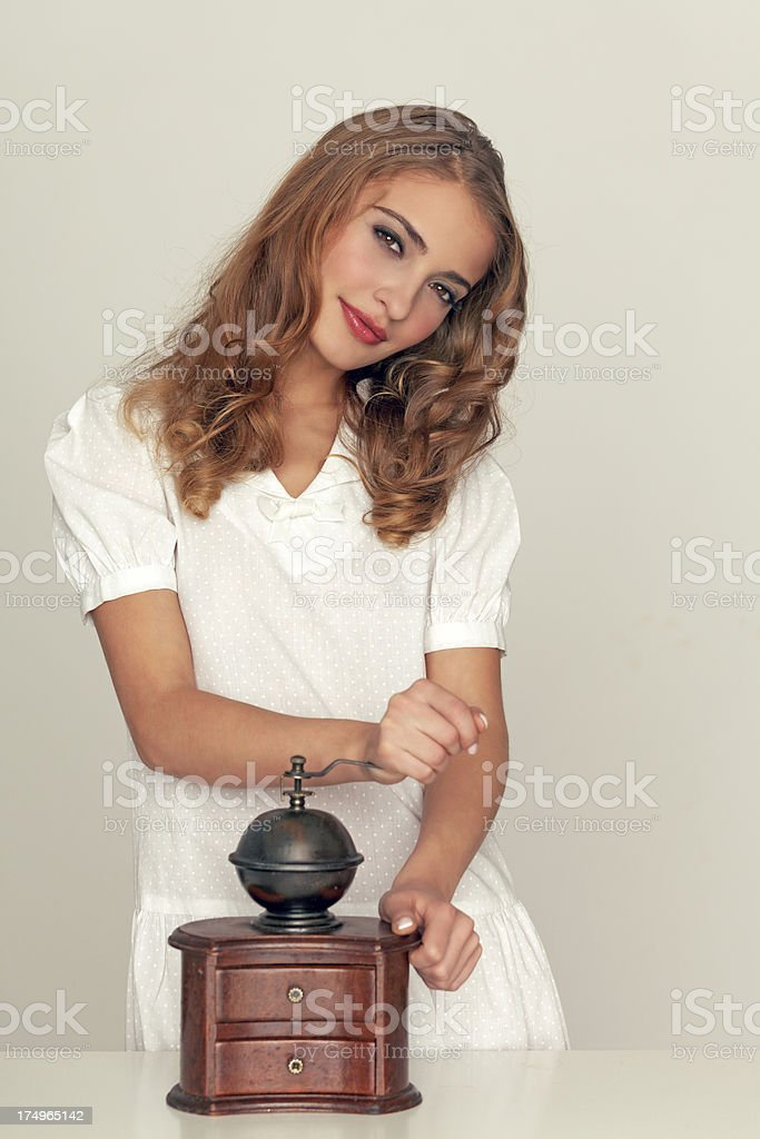 beauty with coffee grinder royalty-free stock photo