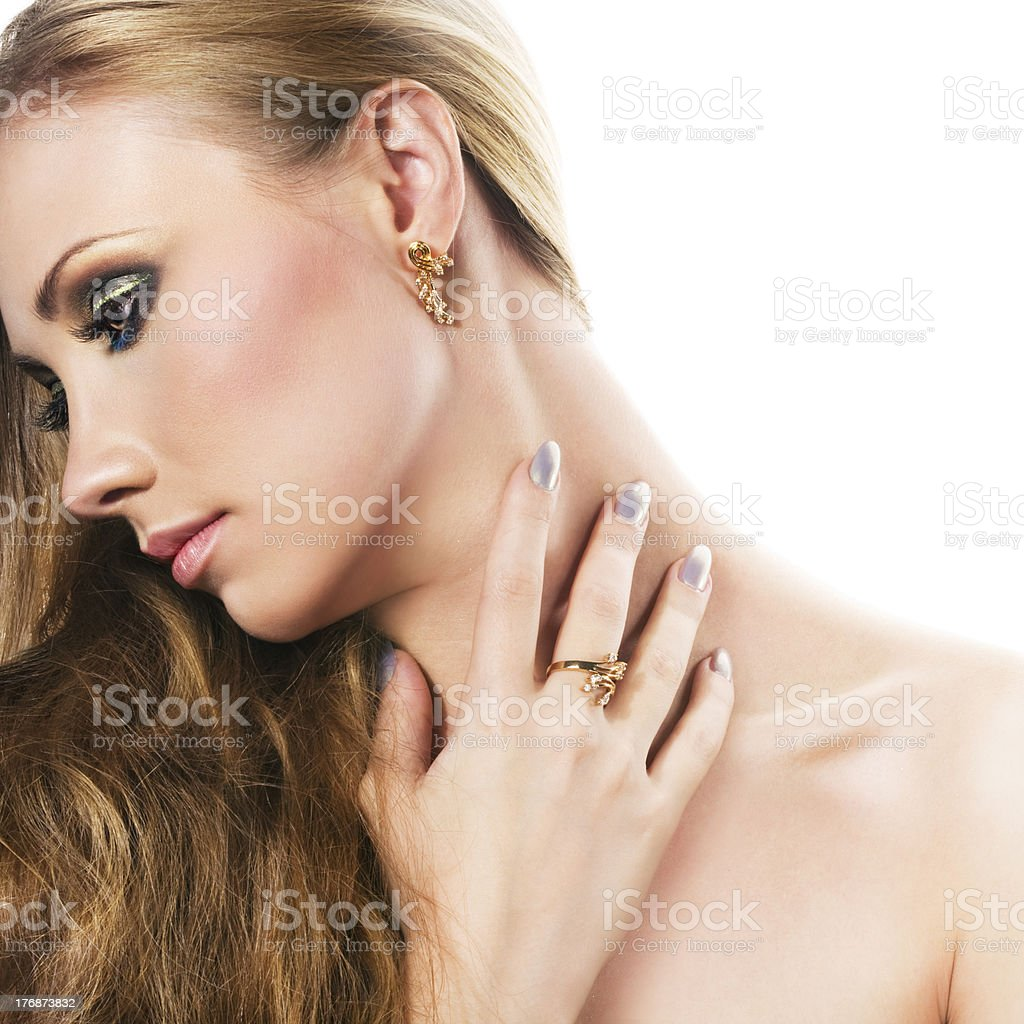 Beauty with gold jewelry royalty-free stock photo
