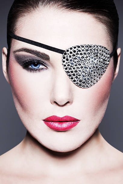 Beauty with Swarovski Eye Patch Creative beauty shot, beautiful woman with eye patch covered with Swarovski stones.  costume eye patch stock pictures, royalty-free photos & images