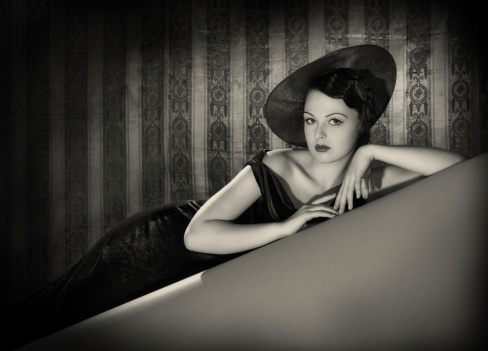 beauty with the hat in film noir style stock photo