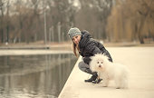 Beauty woman and her dog relax in the park