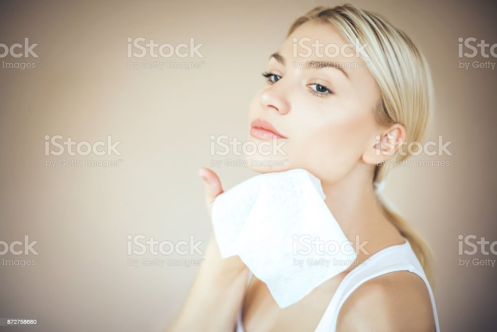 Beauty woman cleaning face. Space for copy. stock photo