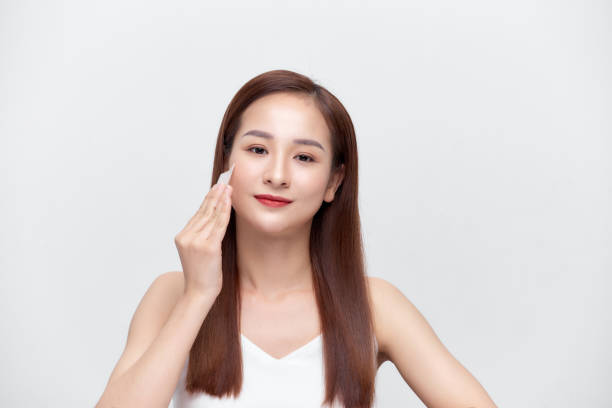 Beauty. Woman Cleaning Perfect Fresh Skin With Oil Absorbing Tissue, Sheets. Beauty. Woman Cleaning Perfect Fresh Skin With Oil Absorbing Tissue, Sheets. blotting paper stock pictures, royalty-free photos & images