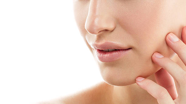 Beauty Woman face lips nose shoulders. model with Perfect  Skin. stock photo
