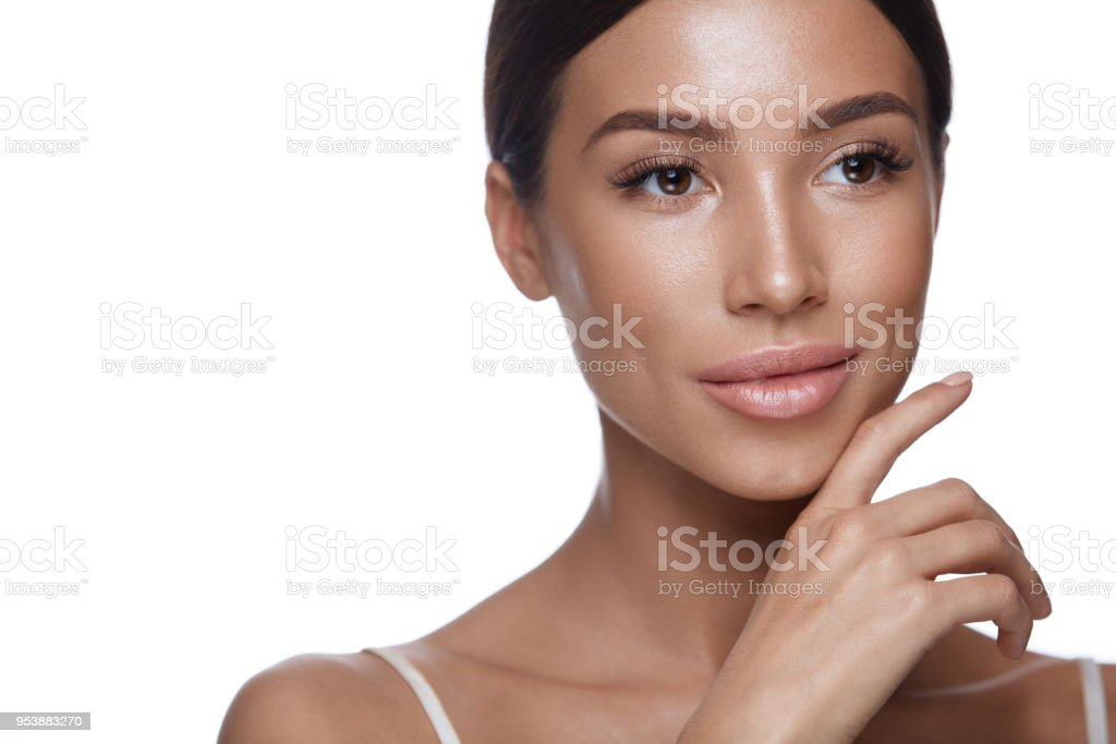 Beauty Woman Face. Portrait Beautiful Female With Perfect Makeup stock photo
