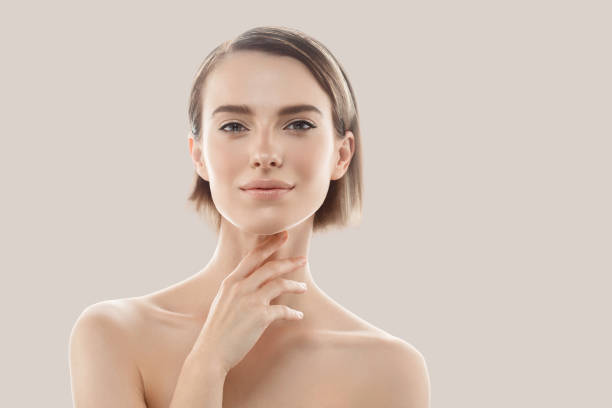 Beauty Woman face Portrait. Beautiful model Girl with Perfect Fresh Clean Skin. stock photo