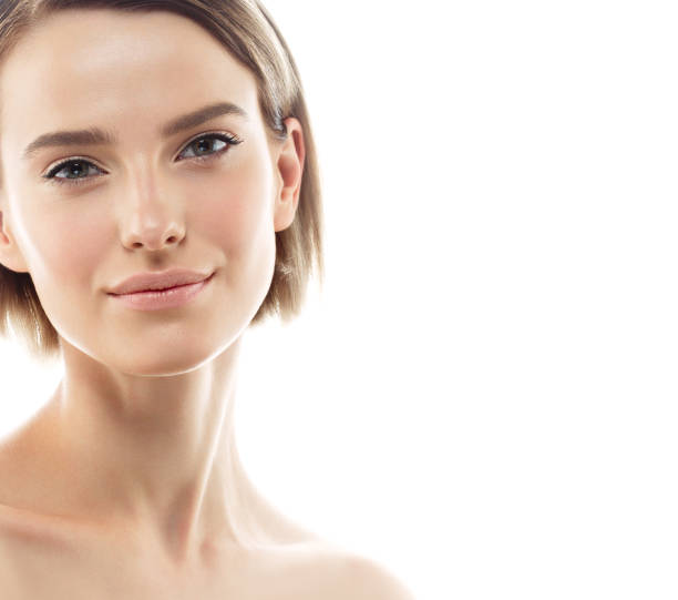 Beauty Woman face Portrait. Beautiful model Girl with Perfect Fresh Clean Skin stock photo