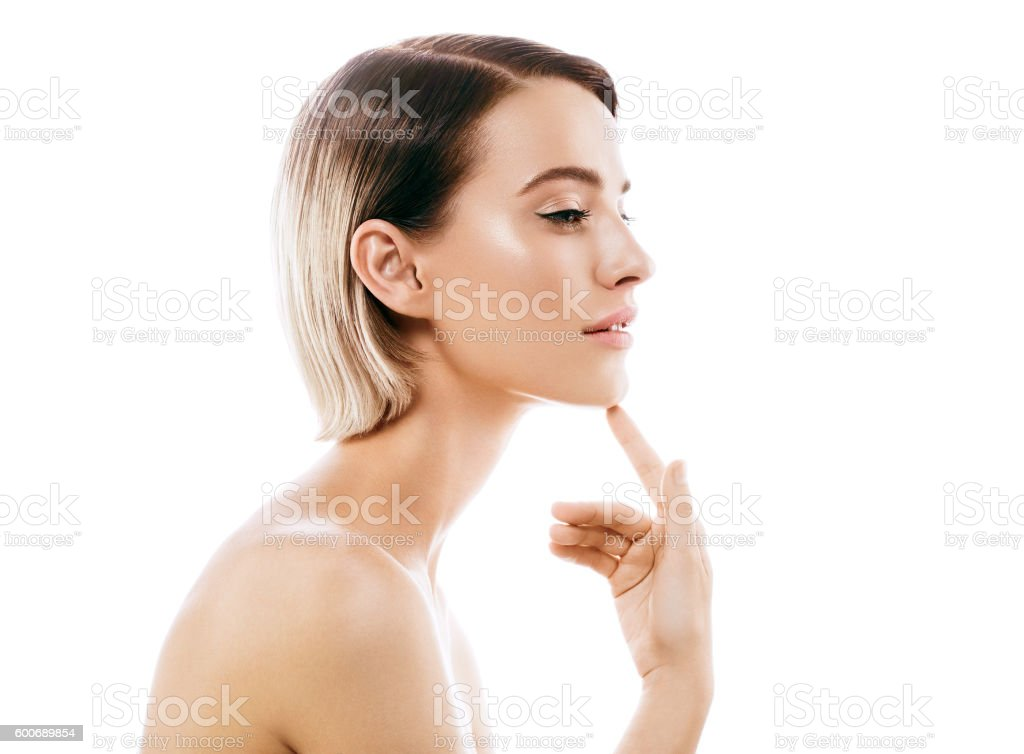 Beauty Woman face with perfect skin Portrait. Isolated on white. stock photo