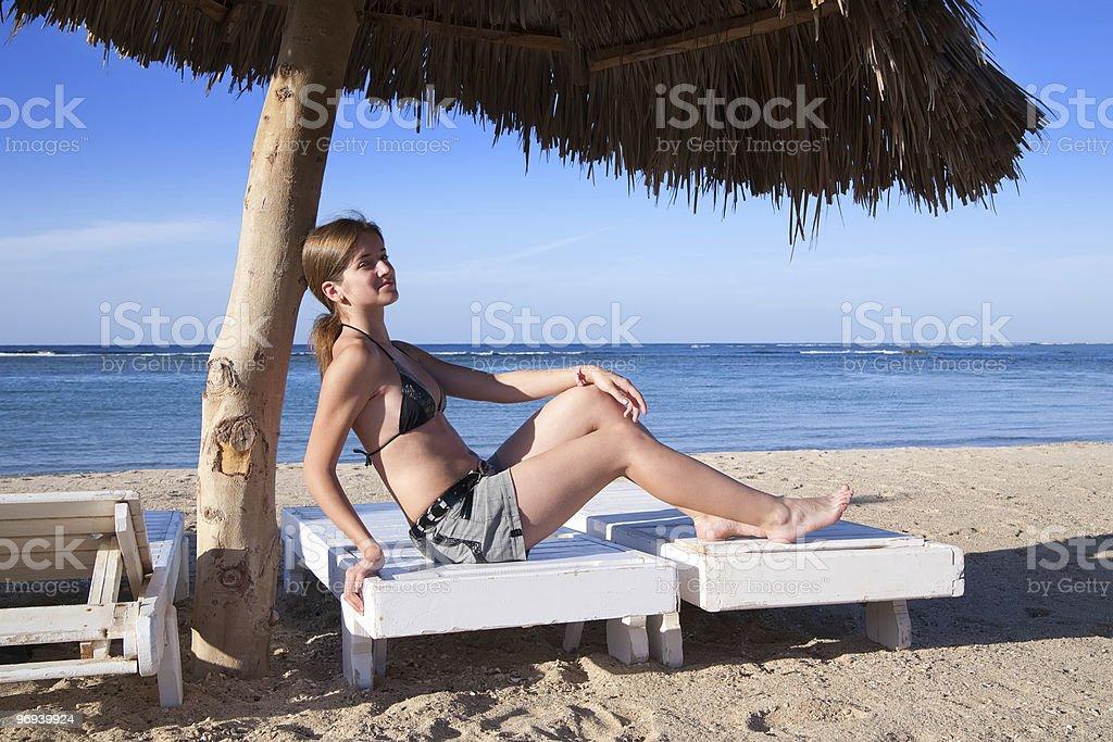 beauty Woman in bikini  sitting on the beach royalty-free stock photo