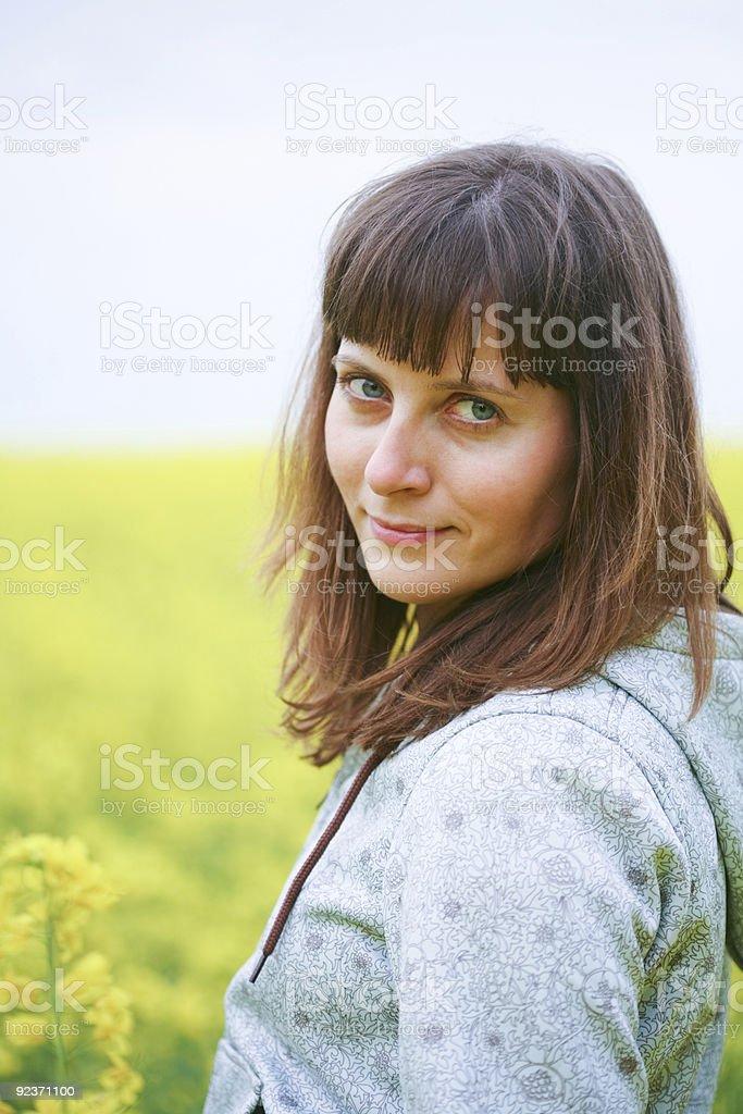 Beauty woman in flower field royalty-free stock photo