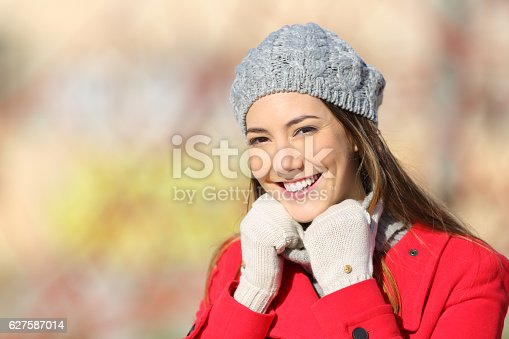 1051172208 istock photo Beauty woman posing warmly clothed in winter 627587014