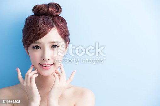 istock beauty woman smile to you 619661808