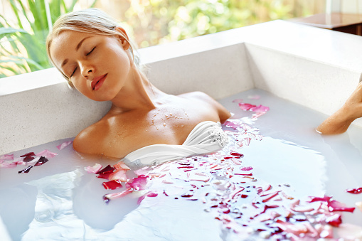 istock Beauty Woman Spa Body Care Treatment. Flower Bath Tub. SkinCare 530746158