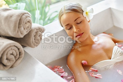 istock Beauty Woman Spa Body Care Treatment. Flower Bath Tub. SkinCare 530747882