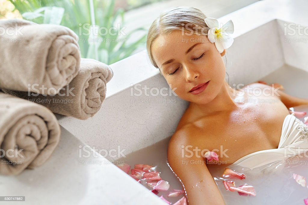 Beauty Woman Spa Body Care Treatment. Flower Bath Tub. SkinCare stock photo