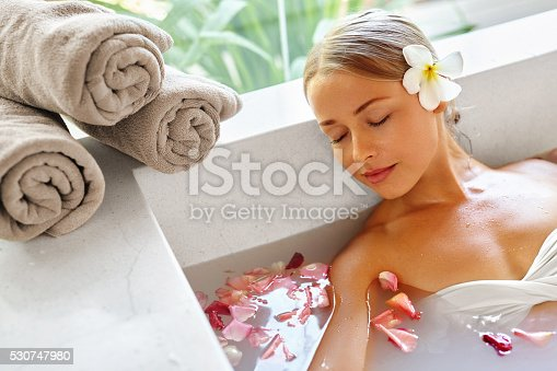 istock Beauty Woman Spa Body Care Treatment. Flower Bath Tub. SkinCare 530747980