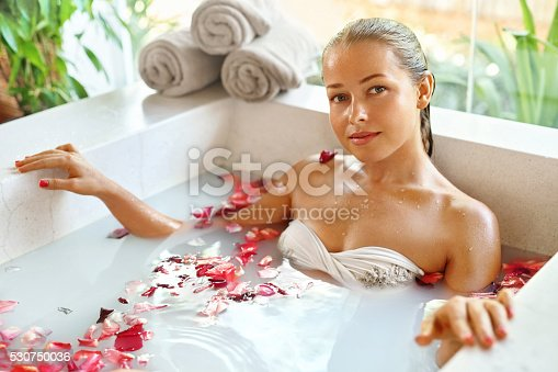 istock Beauty Woman Spa Body Care Treatment. Flower Bath Tub. SkinCare 530750036