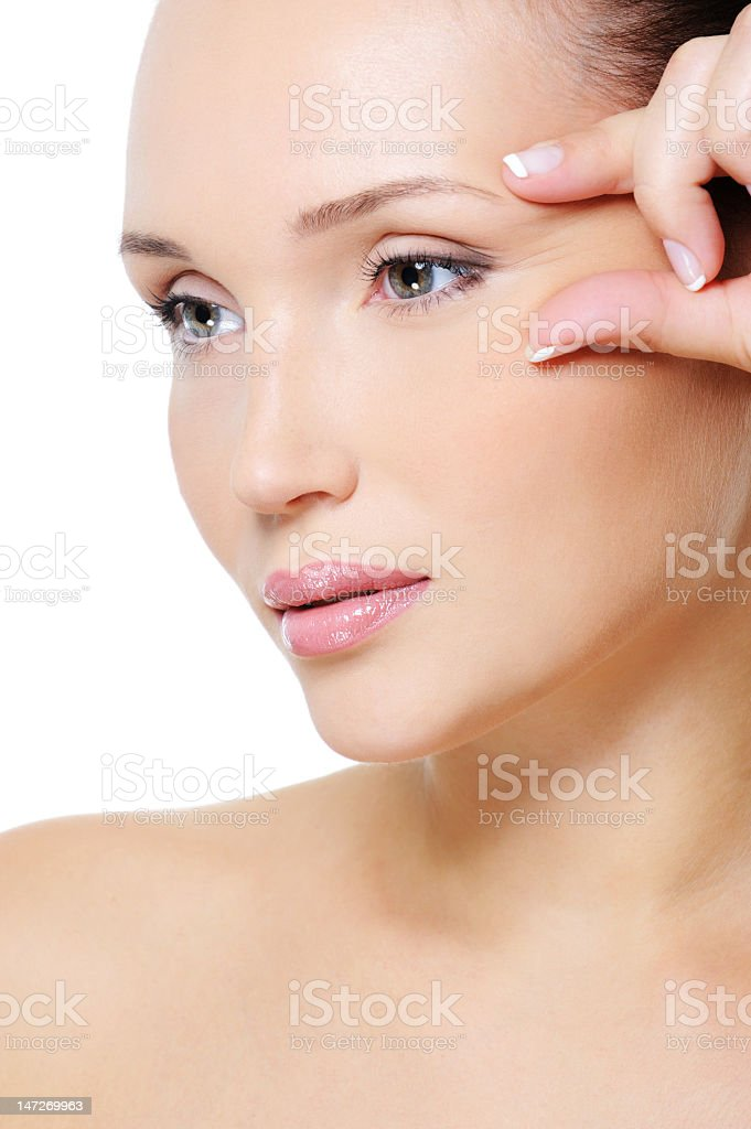 beauty  woman squeeze skin near her eye royalty-free stock photo