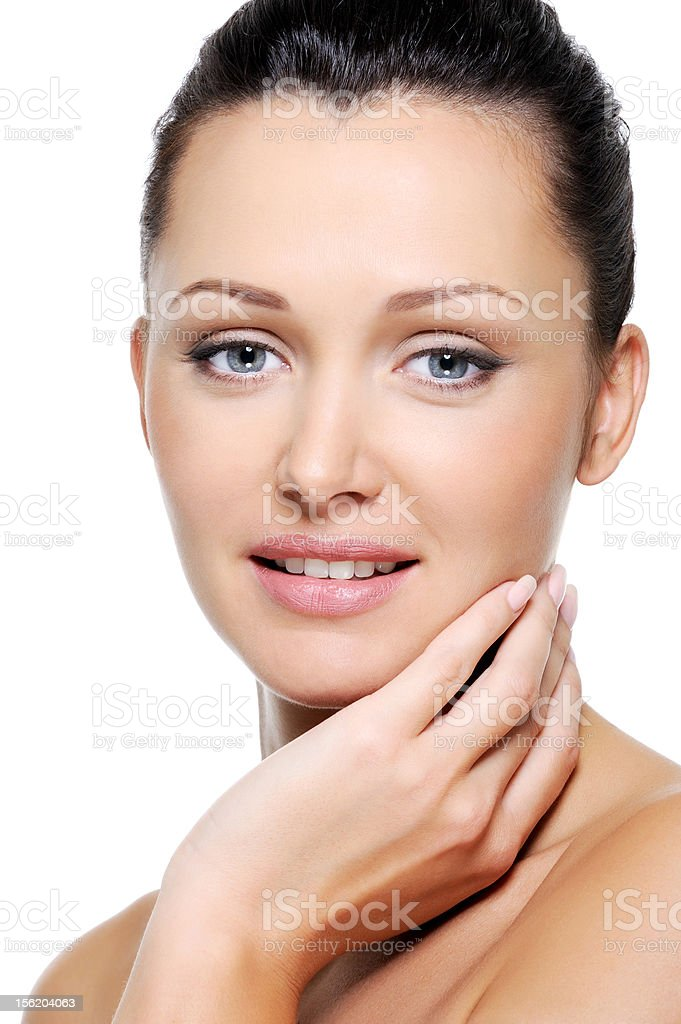 Beauty woman stroking healthy fresh skin of her face royalty-free stock photo