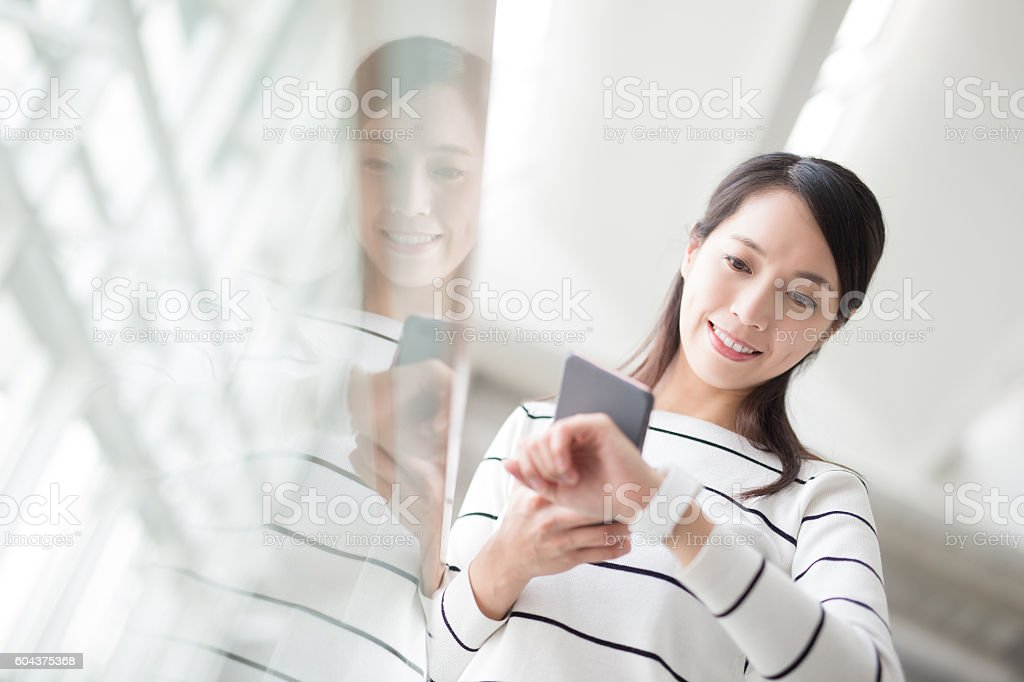 beauty woman take smartphone stock photo