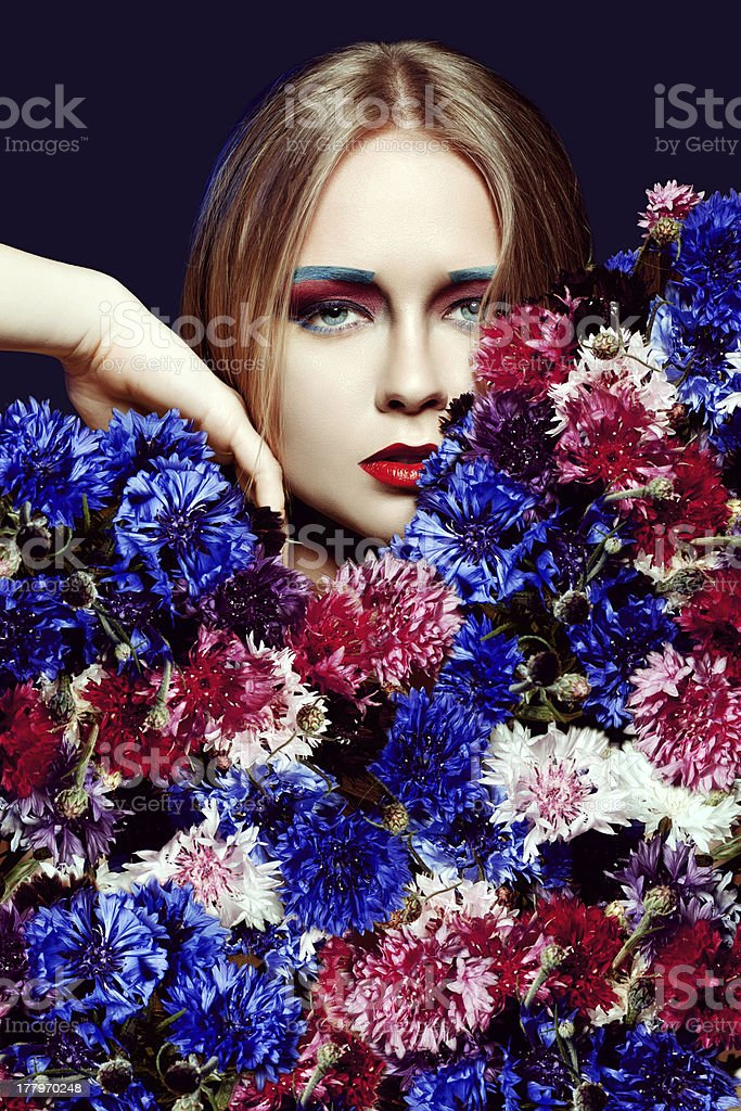 Beauty woman with bunch flowers. Professional Makeup and hairsty royalty-free stock photo